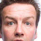 Close-up headshot of comedian Lawrence Mooney.