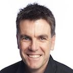 Headshot of comedian Des Dowling smiling.