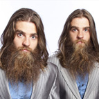 Australian identical twin comedians, The Nelson Twins in matching suits, long hair and beards.