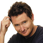 Headshot of Australian comedian Dave Hughes smiling.